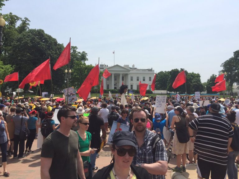 Far Leftists March in Front of the White House with Communist Flags