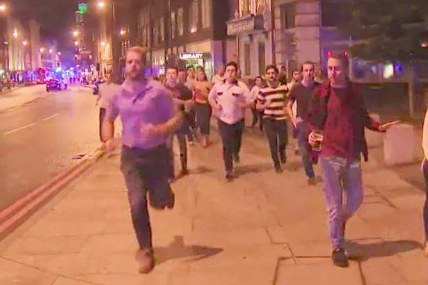 Man Running From Terror Attack With Beer in Hand