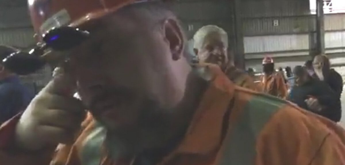 Crying steelworker