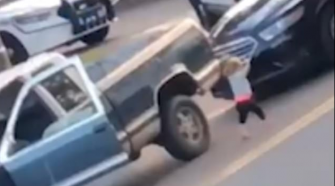 Video Produces Shocking Moment When Barefoot Toddler Walks Toward Armed Police With Hands in the Air
