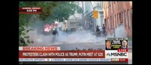G20 Protestor Flips Cops the Bird, Tastes Tear Gas - VIDEO